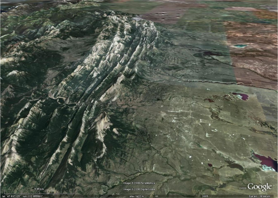 Figure 3.5: The classic compressional mountain ranges are the Front Ranges as you can see in this oblique Google Earth image of the Front Ranges near Augusta, Montana. Click on the image to open a larger version in a new window.