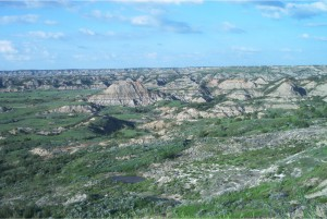 Figure 3.7: In less hospitable climates, like the eastern Montana badlands shown here, the lack of vegetation allows the formation of steep gullies and precipitous hillsides. Click on the image to open a larger version in a new window.
