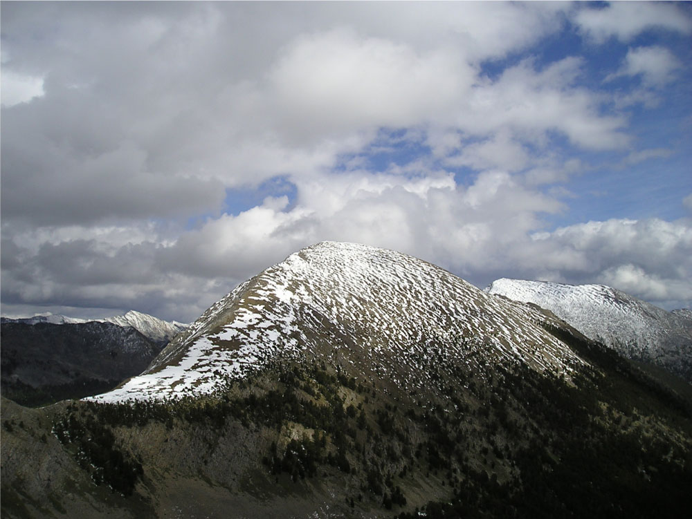 Figure 3.9: The glacial cirque and valley are separated from another glacial valley by the steep-sided arête show here. Click on the image to open a larger version in a new window.