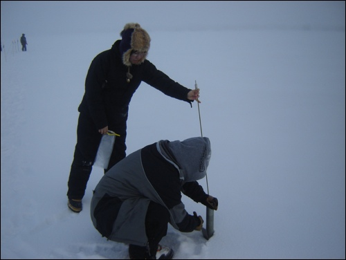 Figure 5.14: Students and teachers collect snow samples. Image from Dr. Delena Norris-Tull.