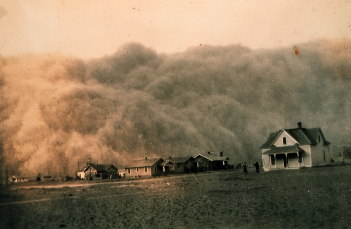 Figure 9.7: In this photo from the NOAA Photo Library, a dust storm approaches Stratford, Texas during the Dust Bowl of America's Great Plains in the 1930's. The loss of topsoil devastated the region's agricultural economy and had serious health impacts on area residents. Image from URL: http://www.nasa.gov/centers/goddard/news/topstory/2004/0319dustbowl.html